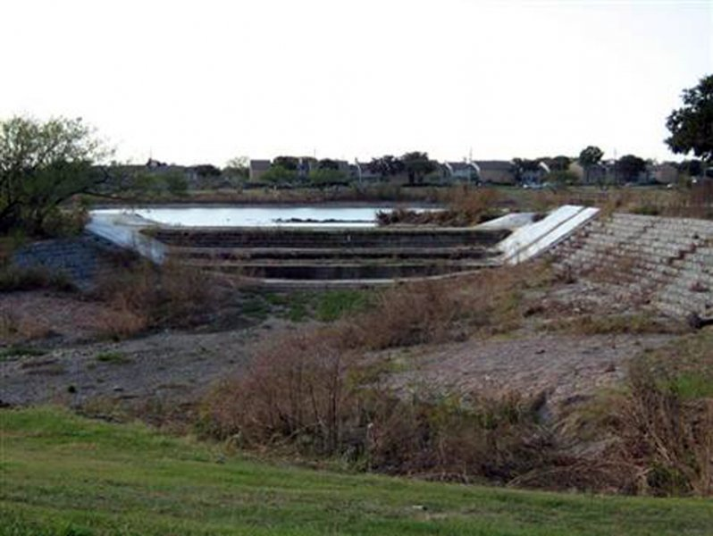 During Dredging - The concrete spillway located at the south end of the lake.