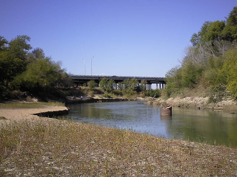 This location is the site of Miller Ferry.  This site was important all throughout the second half of the 1800's.  Notice the fishermen in the background.  That's the South Central Expressway bridge in the distance.