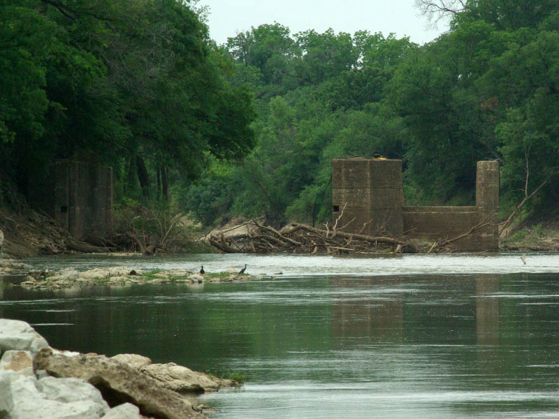 Notice the Double-crested Cormorants standing on the ruins of the 1893 lock and dam.