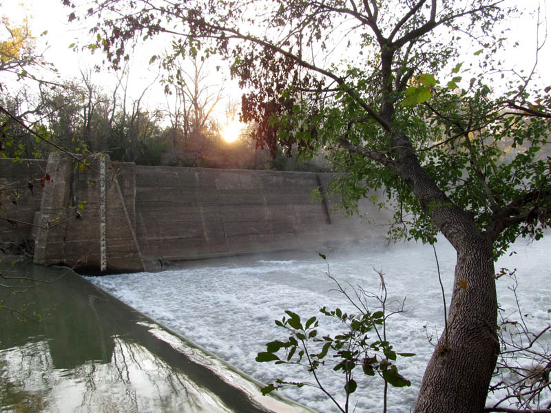 The dam and the spillway.  Notice the depth gauge.  It is marked off up to 19 feet.