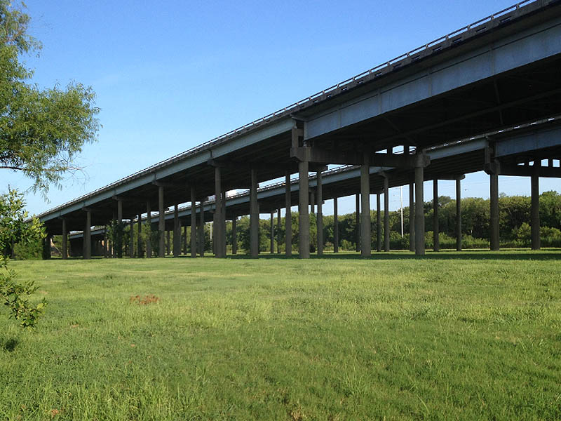 Under the I-20 bridge.