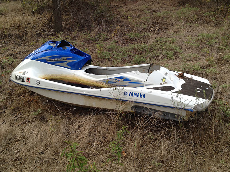 A destroyed wave runner.  The seat cushion was found nearby.