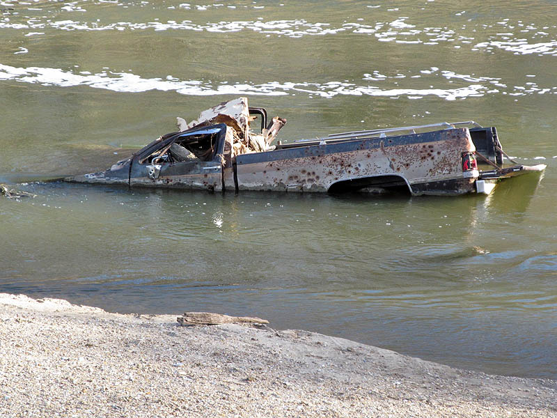 There is no telling how or where this bullet-riddled truck found its way into the river.