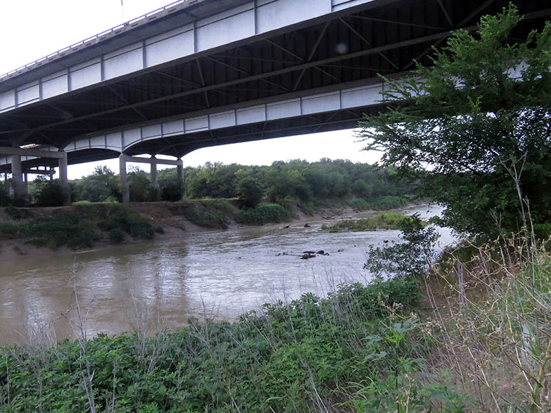 The real Trinity River  as it flows under the massive I-20 bridge.