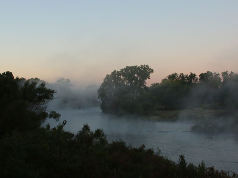 Fog rising off of the Elm Fork of the Trinity River at dawn.